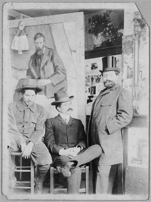 Manach, Torres Fuentes y Picasso ante un retrato de Iturrino.