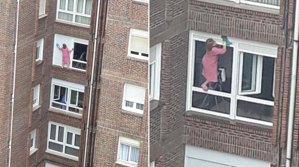 Mujer limpiando ventana